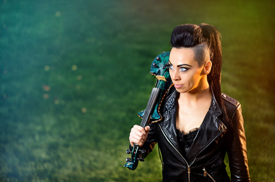 Cristina Kiseleff Beautiful rock violin girl on a green background. Photo by Florin Vitzman