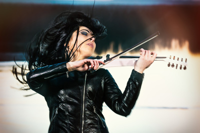 Photo of Cristina Kiseleff dynamic playing of a Cantini Violin. Photo by Florin Vitzman