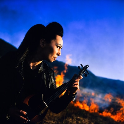 Cristina Kiseleff Firestorm with Blue Skies, Burning Fields and Violin. Shot with a Rolleiflex 2.8C TLR. Photo by Florin Vitzman